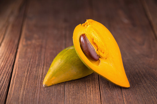 Egg fruit Canistel Yellow Sapote (Pouteria campechiana (Kunth) Baehni) on dark background.