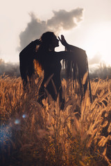 beautiful woman silhouette on sunset