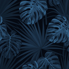 Dark blue denim floral pattern with exotic plants and monstera palm leaves. Vector seamless tropical fabric design.