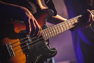 Close-up photo of bass guitar player