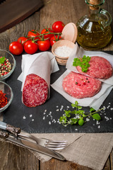 Raw Ground meat Burger and salami