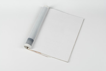 Mock-up magazine or catalog on white table. Blank page or notepad on neutral background. Blank page...