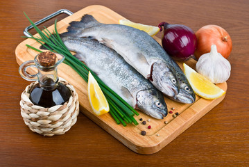 Fresh raw fish trout on wooden board