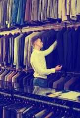 Man choosing new suit