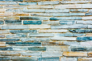 Stone wall texture with blue and orange hue