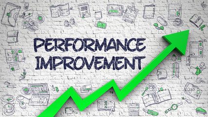 Performance Improvement Drawn on Brick Wall.