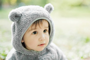 Little boy in a sweater with funny ears