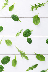 Top view of baby spinach and arugula leaves