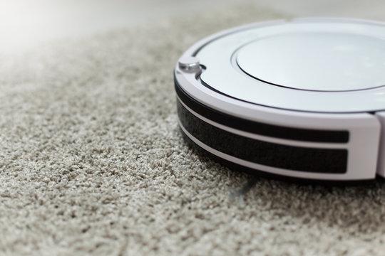 White robotic vacuum cleaner