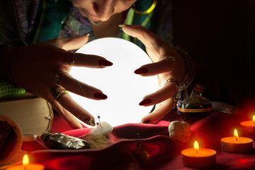 Gypsy fortune teller with crystal ball predicting the future