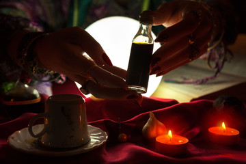 Hands of an fortune-teller holding love potion