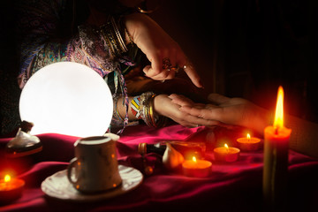 Fortune teller woman reading the future in a hand