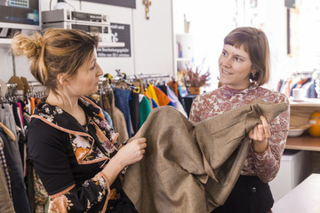 Two women in a second hand shop