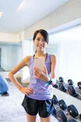 Woman taking selfie in gym