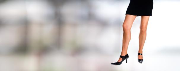 Woman legs with black short dress