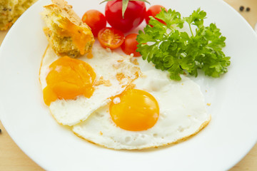 Fried eggs with tomatoes, traditional breakfast