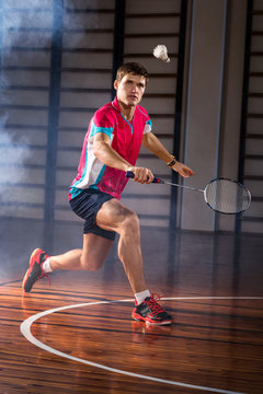 badminton athlete hits a shuttlecock in the gym
