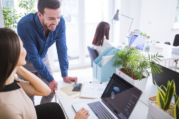 Businessman and Businesswoman Working at Office