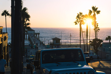 Manhattan beach pier at sunset time in Los Angeles in USA. Sunset in Los Angeles under Pacific ocean