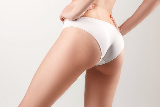 Checking cellulite. Young, slim, healthy and beautiful woman