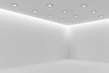 Corner of mpty white room with small round ceiling lamps