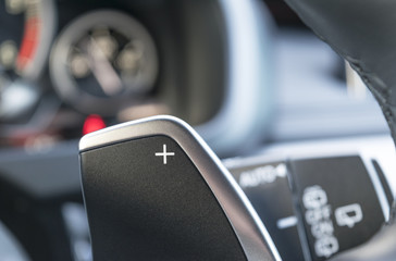 manual gear changing stick on a car's steering wheel, car interior detail