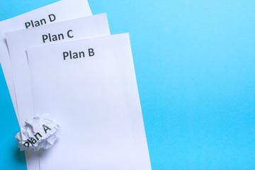 Crumpled paper Plan A and clean sheet Plan B C D
