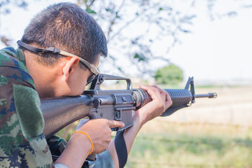 solider sniper asia training shoot gun M16 outdoors