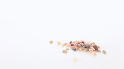 A Few Small Rough Natural Stones on a White Background