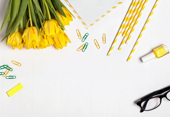 Yellow color tulips and accessories on the white background