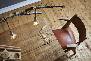 creative workspace birch tree lamp and wood carving scene