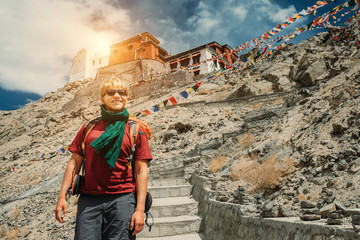 Young man near the tibetan monastery Tsemo Gompa in Leh, North India