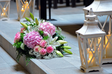 Equipping with pink flowers. hydrangeas and roses. flowers in church. Marriage.