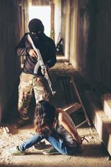 Terrorist hostage threatened women with guns.