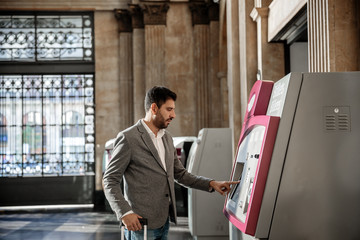 Man buying train tickets