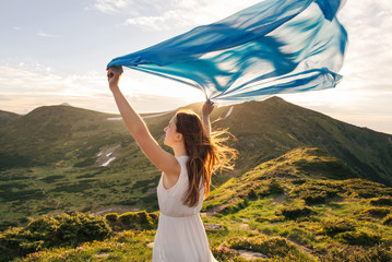 Woman feel freedom and enjoying the nature