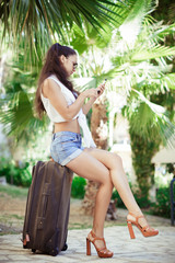 young woman with bag and smartphone