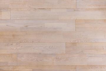 Laminate parquet flooring. Light wooden texture background