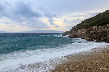 Big waves in the beach and rocks in Datca in stormy weather
