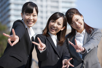 Young Businesswomen Showing Victory Sign