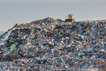 Pollution concept. Garbage pile in trash dump or landfill. Wall mural
