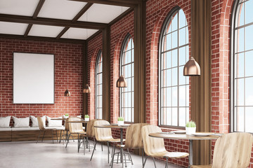 Side view of cafe with chairs, brick