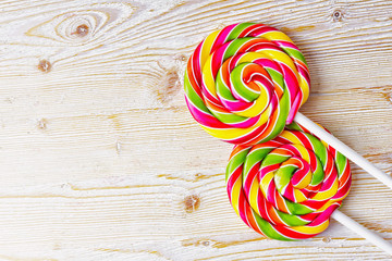 Twisted lollipop on a wooden background
