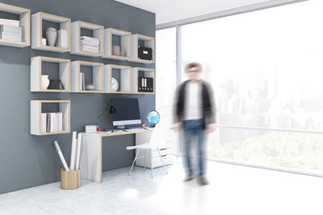 Man near a desk with computer in a home office