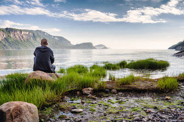 Calm man on vacation admiring a landscape view Wall mural