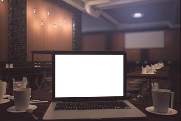 Blank white laptop in bar