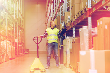 man with loader and clipboard at warehouse