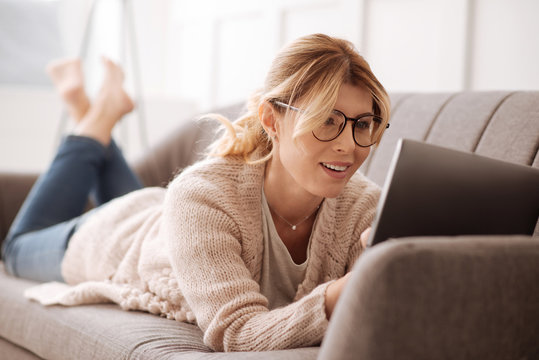 Delighted positive woman working at home