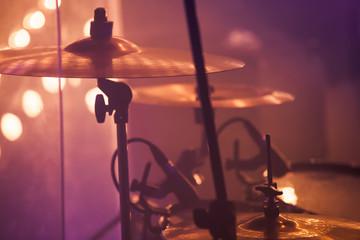 Drummer plays on rock drum set