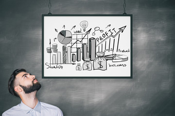 Businessman with business doodle in frame